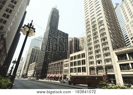 Street view of Chicago downtown. Urban landscape with towers and skyscrapers.