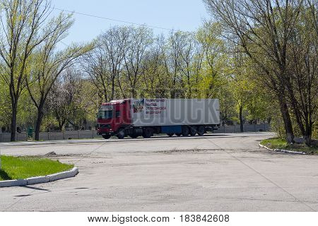 Makeevka Ukraine - April 27 2017: Truck with humanitarian cargo on the city road. The inscription on the car