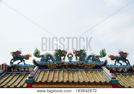 Beautiful Dragon statue and Kylin on top roof in public Chinese temple of Thailand