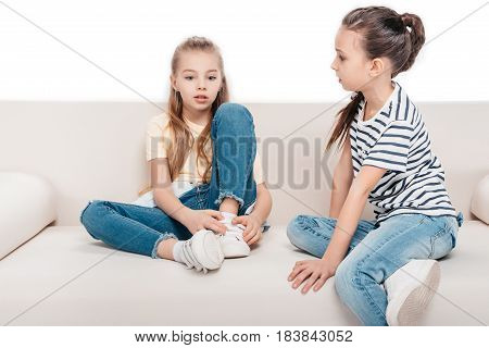 Friends Sitting On Couch