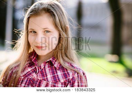 Portrait Of Happy Blond Hair Ten Years Girl