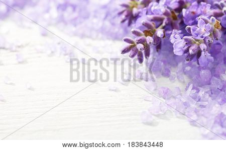 Few sprigs of lavender and  mineral bath salts on  the wooden table.  Shallow DOF. Selective focus