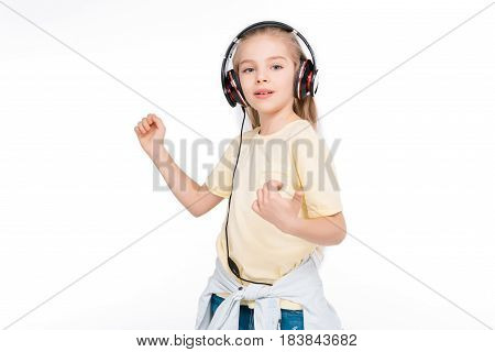 Cute child in headphone listening music isolated in white