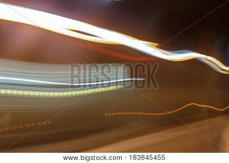Inside tunel blur abstract scene traveling by bus looking in the window upcoming cars
