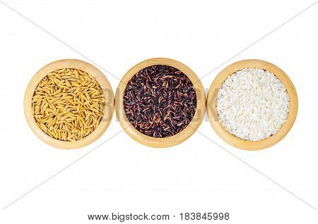 The Different of set raw rice in wooden dish isolated on whie background Save clipping path.