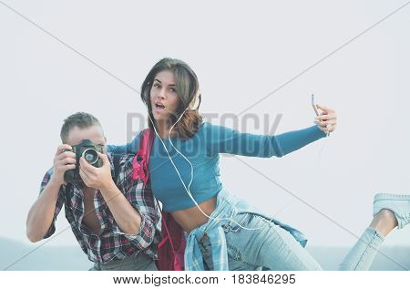 Surprised Girl Taking Selfie With Smartphone And Photographer Photographing