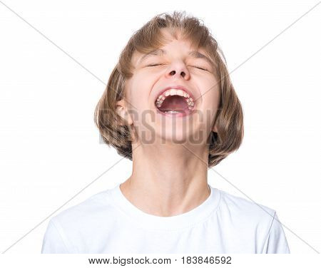 Close-up emotional portrait of caucasian girl crying painfully and screaming. Funny cute child in white blank t-shirt, isolated on white background.