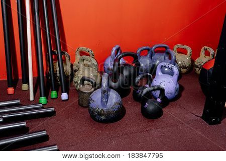 Kettlebells in a gym. Workout with kettlebells. Different sizes of kettlebells weights lying on gym floor. Equipment used for training