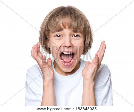 Close-up emotional portrait of caucasian girl crying painfully and screaming. Funny cute child in white blank t-shirt looking at camera, isolated on white background.