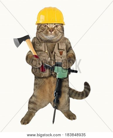 The cat builder is holding a axe in one paw and a jackhammer in other. He is wearing a construction helmet and vest. White background.