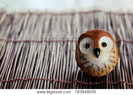 Owl decoration on wooden table on blur background