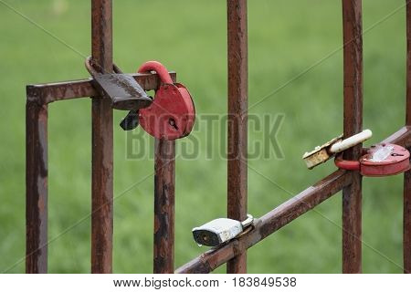 Rusty love locks hanging on the fence as a symbol of loyalty and eternal love