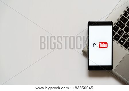 Bratislava, Slovakia, April 28, 2017: Youtube logo on smartphone screen placed on laptop keyboard. Empty place to write information.