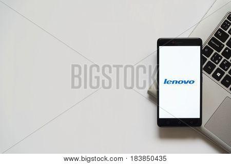 Bratislava, Slovakia, April 28, 2017: Lenovo logo on smartphone screen placed on laptop keyboard. Empty place to write information.