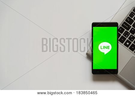 Bratislava, Slovakia, April 28, 2017: Line logo on smartphone screen placed on laptop keyboard. Empty place to write information.