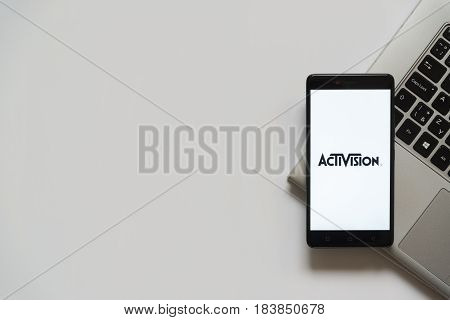 Bratislava, Slovakia, April 28, 2017: Activision logo on smartphone screen placed on laptop keyboard. Empty place to write information.