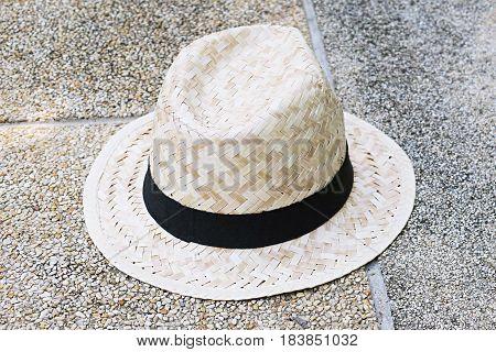 Woven hat on floor. Bamboo handmade hat. Vintage woven hat