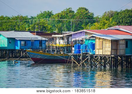 Semporna,Sabah-Apr 22,2017:View of Sea Bajau's water village with the boat in Semporna,Sabah,Borneo on 22nd Apr 2017.