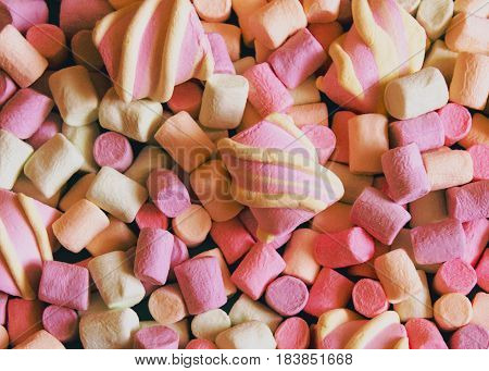 Marshmallows Background or texture of colorful mini marshmallows Texture of multi-colored marshmallows in different sizes and shapes