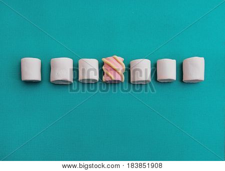 Marshmallows Background or texture of colorful mini marshmallows Seven different marshmallows are lying on a blue background