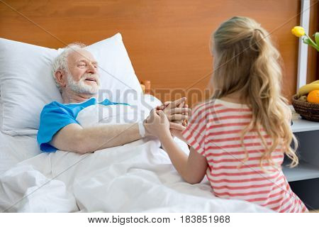 Grandfather And Child Holding Hands