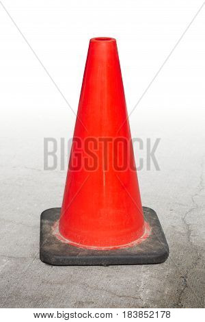 isolated orange traffic cone on concrete white background