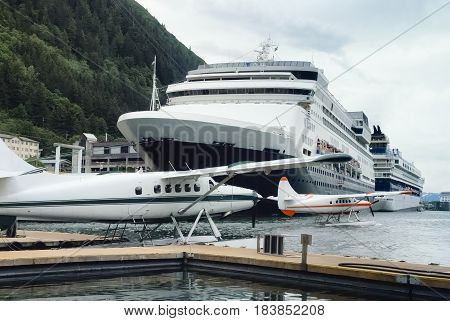 Seaplanes and cruise ships at the busy port of Juneau Alaska