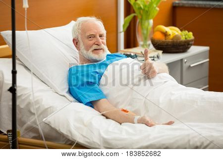 Senior Man In Hospital Bed