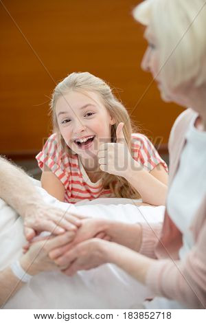 Relatives With Senior Man In Hospital
