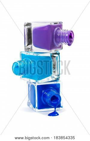 Stack of blue nail polish isolated on the white background