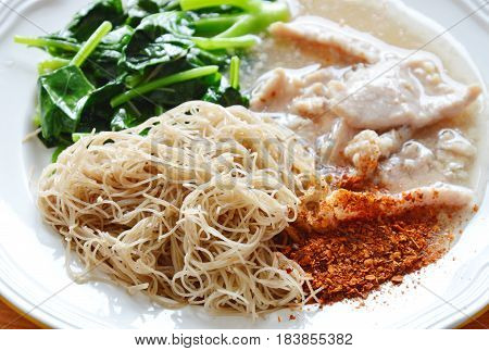 fried thin rice noodle dressing pork gravy sauce on plate