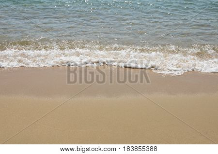 sea water surf to beach in sunny day