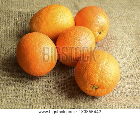 Oranges are on a table. Fruit are fresh juicy mature tropical