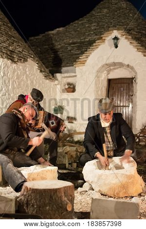 Cisternino Italy - January 01 2017: Ancient work representation at the living crib of Casalini di Cisternino (Italy)