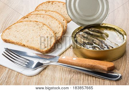 Jar With Sparts In Oil, Pieces Of Bread