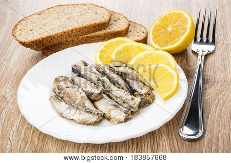 Plate With Sparts And Lemon, Pieces Of Bread And Fork