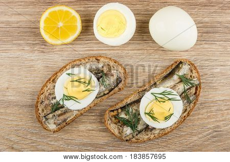 Sandwiches With Sparts In Oil, Eggs, Lemon And Boiled Egg