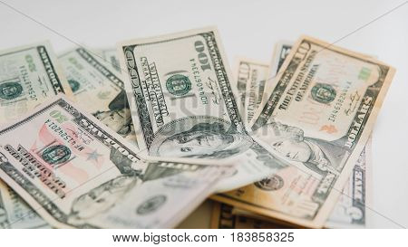 The Dollar Bills Of Different Denominations Lying On The Table. Earnings In Dollars