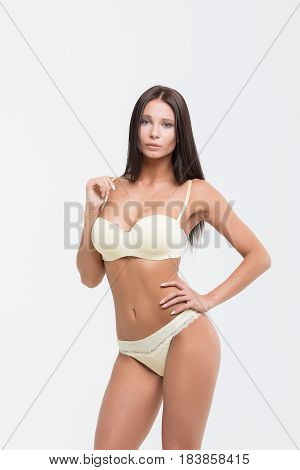 Sexy blonde woman on white background. Perfect womans body