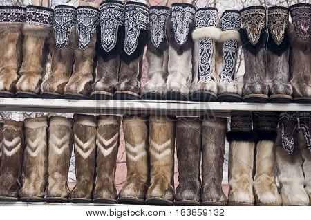 Nenets boots from deer fur are selling in the winter street