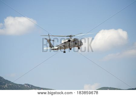 Black hawk helicopter rescue team,Nose up take off blue sky mountain back ground