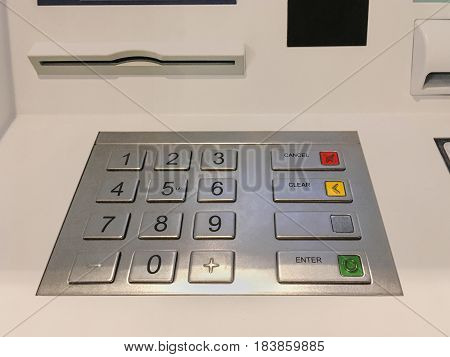 Metallic pinpad in ATM machine or payment terminal.