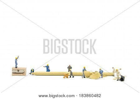 Miniature Worker Team Sharpening A Pencil