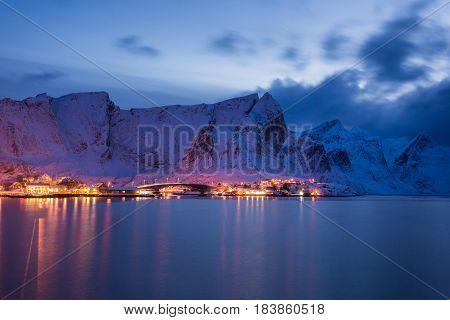 Snowy fishing village in the Lofoten islands at night