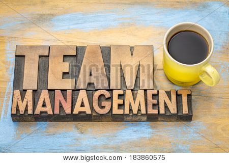 team management banner in vintage letterpress wood type with a cup of coffee