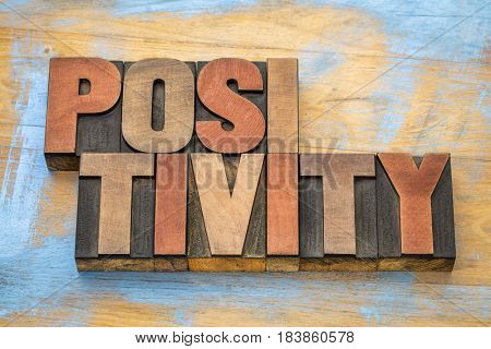 positivity word abstract in in vintage letterpress wood type
