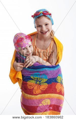 Girls wrapped in a towel on a white background