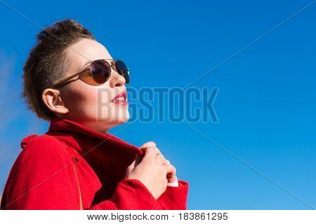 Girl In Glasses Posing Against The Sky