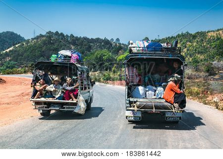 KALAW, MYANMAR-MARCH 5,2017: Burmese people on the light trucks in Kalaw on March 5, 2017, Myanmar.They are used as a taxi because people can