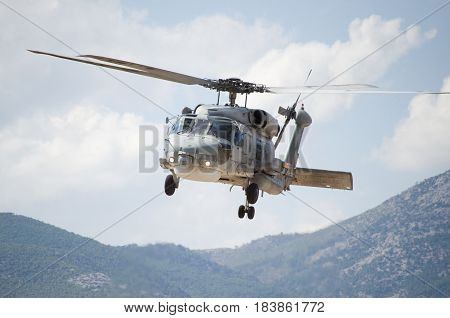 Black hawk helicopter rescue team,close upnose down low flight maneuvering